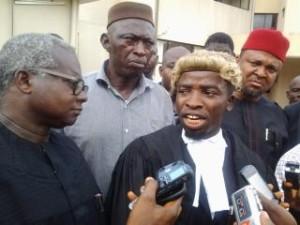 APGA lawyer addressing newsmen at the court premises