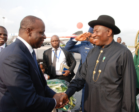 PRESIDENT GOODLUCK JONATHAN (R) BEING RECEIVED BY THE IVORIAN MINISTER FOR AFRICAN INTEGRATION, MR ALI COULIBALY