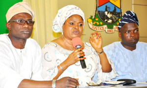 Lagos State Deputy Governor, Hon. (Mrs.) Adejoke Orelope-Adefulire (middle), flanked by Commissioner for Information and Strategy, Mr. Aderemi Ibirogba (left), and the Special Adviser to the Governor on Media, Mr. Hakeem Bello (right), answering questions from Pressmen during a briefing on the state of a pregnant woman, Alexandra Ossai  allegedly battered by her Lebanese boss, Kaveh Noine, at Toppan Printing Company in Ikeja, Lagos at the Banquet Hall, Lagos House Ikeja, on Friday, January 3, 2014.