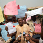 Photo News: Abuja Traders Protest Plans By FCT to Allocate Their Shops to New Owners