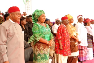 Gov. Theodore Orji of Abia state, his wife Mercy, Deputy governor Sir Emeka Ananaba and his wife Nene, Chief Onyema Ugochukwu and Mrs. Sararh Jubril observing the national anthem at a Grand civic reception in honour of the governor by Ikwuano/ Umuahia in Umuahia.