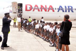 Pupils of Lily vale schools, Akute, Lagos and Greensrich schools, Ikorodu, Lagos being received by Chief Pilot, Dana Air, Capt. Segun Omole during the schools excursion to Dana Air at Murtala Mohammed Airport, Ikeja, Lagos