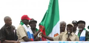 Comrade Oshiohmole presents APC flag to decampee Lawmaker