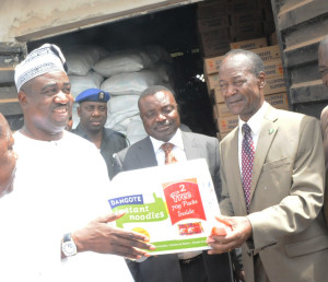 L-R: Governor of Benue State, Dr. Gabriel Suswam receives a Noodle pack from the Special Adviser to the President of Dangote Group, Eng. Joseph Makoju while Head, Dangote's special Duties, Gboko Plant, Dr. Bem Mellad looks on.