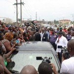 Delta State Governor, Dr. Emmanuel Uduaghan (holding microphone) interacting with market men and women during his inspection of the on-going clean-up at Refinery Road , Warri, Thursday.