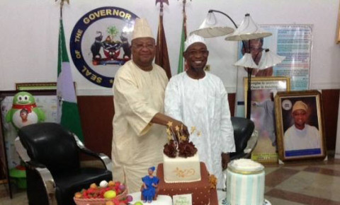 Senator Adeleke (PDP) Cuts Birthday cake with Gov Aregbesola on the occasion of the governor's birthday