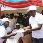 Kwara State Governor, Dr Abdulfatah Ahmed yesterday flagged-off the Quickwin Empowerment Scheme with the employment of an initial 5200 youths. Pix shows Governor Ahmed presenting letters to some of the beneficiaries and examining Quickwin equipment