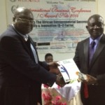 L-R: Director of Special Duties, Mish Aviation, Ghana, Mr. Sam Winful, receiving the Aviation Training Excellence in Africa award on behalf of Chief Executive, Captain Ibrahim Mshelia  from the Deputy Executive Director, Ghana Standard Board, Mr. Kofi Nagetey at the 6th International Business Conference held at the African Royal Beach Hotel, Ghana