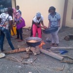 LASU female students cooking at the entrance to Fashola's office