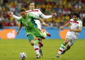Peter Odemwingie of Nigeria L in action against Khosro Heydari R and Andranik Timotian of Iran C during the FIFA World Cup 2014 group F preliminary round match between Iran and Nigeria