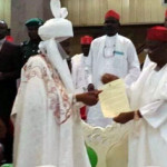 New Emir Sanus (L) receives letter from Kano State governor, Musa Kwakwaso