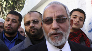 Mohamed Badie, the leader of the Muslim Brotherhood, queues outside a polling centre to vote in the final stage of a referendum on Egypt's new constitution in Bani Sweif