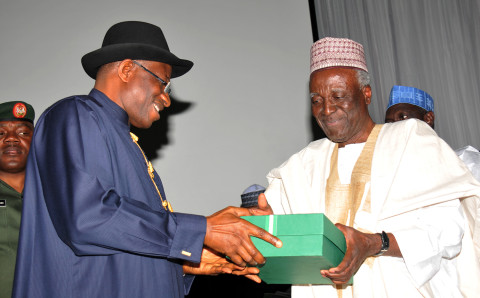 President Jonathan (L) receives reports of the National CONFAB from it  chairman Kutigi