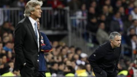 Pellegrini-Mourinho-Reuters-Bernabeu-2012-