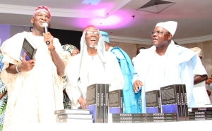 "Lagos State Governor, Mr. Babatunde Fashola, SAN (left) presenting the Book, ""POSSESSED – A History of Law and Justice in The Crown Colony of Lagos 1861 – 1906"", written by former Lagos State Attorney-General and Commissioner for Justice, Mr. Olasupo Shasore, SAN during the Book Presentation at the City Hall, Victoria Island, Lagos on Friday, October 17, 2014. With him is Chairman, Lagos State Microfinance Institution, Bashorun Alabi Macfoy (middle)."