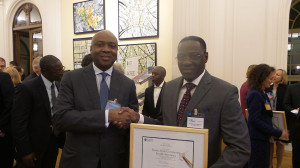 Former Governor of Kwara State, Senator Bukola Saraki congratulates his successor Governor Abdulfatah Ahmed at the OECD Development Assistance Committee awards in Paris