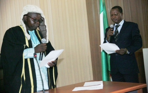 New Speaker Ekiti State house of Assembly Rt. Hon Dele Joseph Olugbemi (L) taking the oath of office before the Clerk of the house Mr Tola Esan during the swaring-in of the Speaker Ekiti State house of Assembly in Ado Ekiti on Thursday