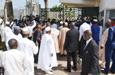 Police lock out speaker Aminu Tambuwal and other members of House of Representatives  during a siege on the national assembly in Abuja on Thursday (20/11/14)