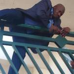Hon. Kawu Suleiman, deputy minority leader Scales the fence of the National Assembly.