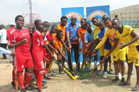 Head, Legal and PR, Promasidor Nigeria Limited Andrew Enahoro,  Shesan Owonubi of BME Concern/ Ripples and some of the students during the donation of hockey sticks in Lagos.