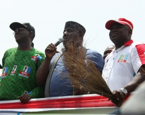 Lagos State Governor, Mr. Babatunde Fashola, SAN (left), his Imo State counterpart, Owelle Rochas Okorocha (middle) and the All Progressives Congress (APC) Governorship Candidate in Lagos State, Mr. Akinwunmi Ambode (right) during the All Progressives Congress (APC) Governorship Campaign Rally at Amuwo-Odofin Local Government Area, Lagos, on Monday, March 09, 2015.