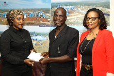 REWARD WELL DESERVED: Adamu Nahuta,(middle), receiving a cheque of N500,000.00 from Maijidda Modibbo (left) of Corporate Communication, Dangote Group and Nike Sanmi Adebayo (right) Customer Care, Dangote Cement for helping to arrest a Dangote truck driver involved in illegal haulage in the on-going campaign by the Group against the use of its truck for illegal haulage.