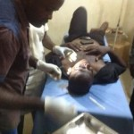 A victim of the demotion protest receives medical attention
