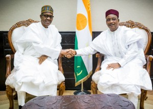 PIC 1. PRESIDENT MUHAMMADU BUHARI (L) IN A HANDSHAKE WITH PRESIDENT ISSOUFUO MAHAMADOU OF NIGER REPUBLIC DURING A MEETING IN NIAMEY ON WEDNESDAY (3/6/16). 0001/JUNE2015/BAYO/CALLISTUS/SH