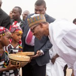 PIC 3. PRESIDENT MUHAMMADU BUHARI WITH SOME CHILDREN WHO PRESENTED HIM WITH A CALABASH CONTAINING KOLANUT DURING HIS ARRIVAL AT THE NIAMEY INTERNATIONAL AIRPORT NIGER REPUBLIC ON WEDNESDAY (2/6/15).