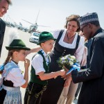 PIC 4. PRESIDENT MUHAMMADU BUHARI (R) RECEIVING BOUQUET  OF FLOWER FROM CHILDREN ON HIS 
