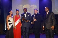 Transcorp Hotels Plc CEO Valentine Ozigbo and Transcorp Hilton Abuja GM Etienne Gaillez surrounded by well-wishers after receiving an impressive five awards during the 2015 World Travel Awards in Seychelles at the weekend