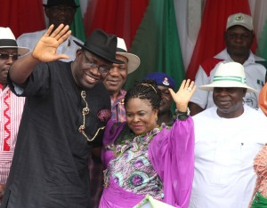 Governor of Bayelsa State, Hon. Seriake Dickson (left) accompanied by the former 1st lady, Dame Patience Jonathan (centre) acknowledging cheers from the mammoth crowd on their arrival during the Governor's declaration for 2nd term in office, at the Samson Siasia Sports Complex in Yenagoa, while the 1st Civilian Governor of the State, Chief Diepreye Alamieyeseigha (right) looks on in Yenagoa (Tuesday) September 8 2015