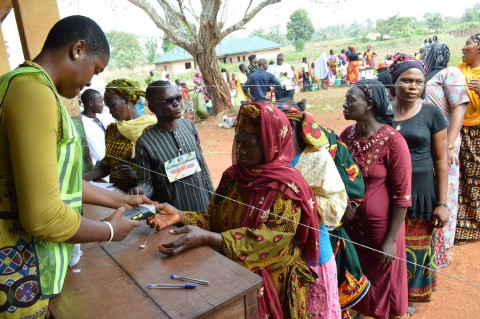 PIC. 2. INEC ADHOC STAFF TAKING FINGER PRINTS OF VOTERS DURING ACCREDITATION FOR KOGI GOVERNORSHIP ELECTION IN AGBNOCHA, OFU LOCAL GOVERNMENT AREA ON SATURDAY (21/11/15). 7305/20/11/2015/BJO/NAN