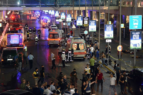 Turkish rescue services gather outside Istanbul's Ataturk airport, Tuesday, June 28, 2016. Two explosions have rocked Istanbul's Ataturk airport, killing several people and wounding others, Turkey's justice minister and another official said Tuesday. A Turkish official says two attackers have blown themselves up at the airport after police fired at them. The official said the attackers detonated the explosives at the entrance of the international terminal before entering the x-ray security check. (Ismail Coskun, IHA via AP) TURKEY OUT