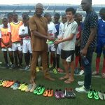 13 Year Old American Footballer Donates Dozens of Soccer Boots To Peers In Enugu