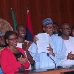 "Photo: Buhari Signs ""Not too Young to Vote"" Bill into Law"