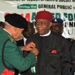 Gov. Theodore Orji of Abia state being decorated by the interim Chairman, Nigerian Legion, Abia state chapter Col. F.C.Agbaja during the 2014 Armed Forces Remembrance Day Emblem Lunch in Umuahia.