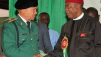 Theodore Orji of Abia state in a handshake with the interim Chairman, Nigerian Legion, Abia state chapter Col. F.C.Agbaja during the 2014 Armed Forces Remembrance Day Emblem Lunch in Umuahia.