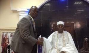 The President of the Nigerian Council of Registered Insurance Brokers, Mr Ayodapo Shoderu making a presentation to the Alake of Egabland, Oba Adedotun Aremu Gbadebo during his visit to his palace in Abeokuta, on Wednesday, November 20, 2013