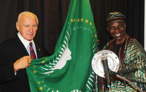 CEO Dr. Thomas P. Rosandich and Amb. Tunde with the USSA Award.