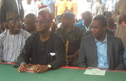 Governor Babatunde Fashola of Lagos State (Middle), Commissioner for Works and Infrastructure, Dr Kadri Obafemi Hamzat (Right) and Mr Bolaji Yusuf Ayinla (Left)