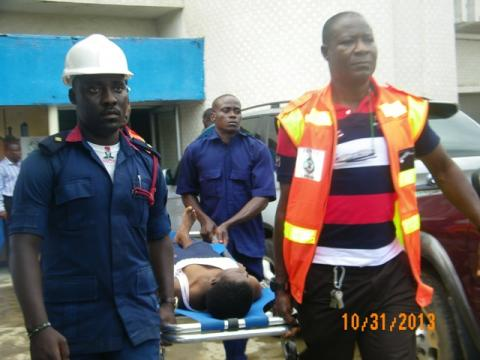 One of the students being rushed to the hospital