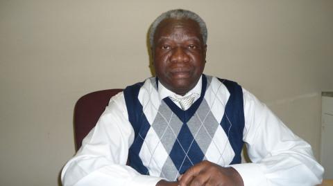 Dr. Olusola