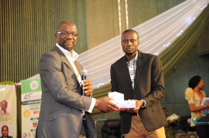 L-R: The Director, Conrad Clark presenting the Award to Alao Idris Ibrahim (the 2nd runner-up winner) during the 45th Annual National Conference of the Chartered Institute of Personnel Management (CIPM) held at the Abuja International Conference Centre between 18th-20th September, 2013.
