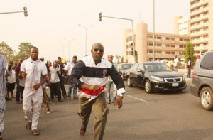 Dino Melaiye, during a protest in abuja