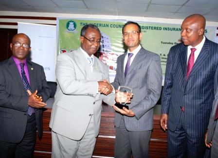 Deputy President of the Nigerian Council of Registered Insurance Brokers (NCRIB), Mr. E. K. Okunoren; NCRIB President, Mr. Ayodapo Shoderu; Acting Managing Director/CEO, Wapic Insurance Plc, Mr. Ashish Desai, and Executive Director, Technical, Wapic Insurance Plc, Mr. Folusho Alliyu, at the Wapic sponsored NCRIB members evening held in Lagos on Tuesday, December 17, 2013.