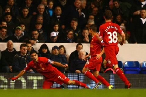 Suarez celebrates his first goal against spurs on Sunday