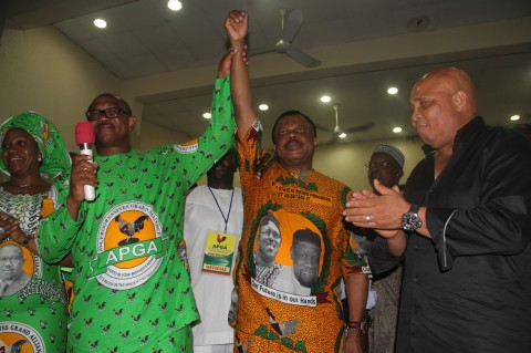 Out Going Governor Peter Obi Raises Hand of the Elected Governor of Anambra state Chief Willy Obiano