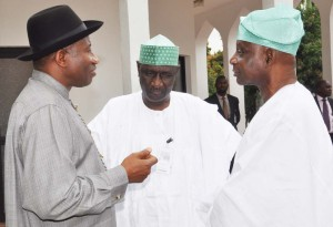 President Jonathan (left) chatting with the Chairman of the Advisory committee, Femi Okunrounmu (R) and a member of the committee