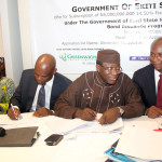 Photo News: Ekiti State Governor, Dr Kayode Fayemi Signs Twenty Five Billion Naira (25, 000, 000, 000) Ekiti State Bond in Lagos on Tuesday 12/31/2013